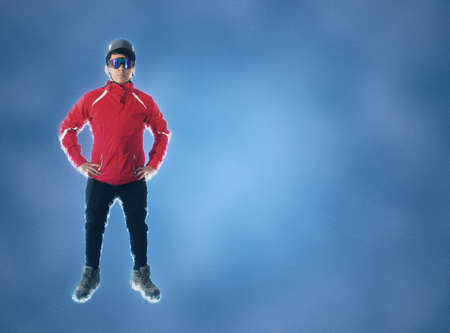 full length portrait of hiker with mask and helmet on blue background
