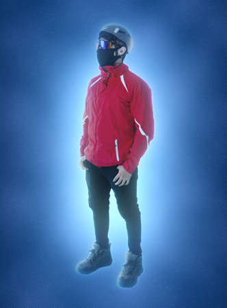 full length portrait of hiker with mask, glasses, helmet and boots on blue background Zdjęcie Seryjne