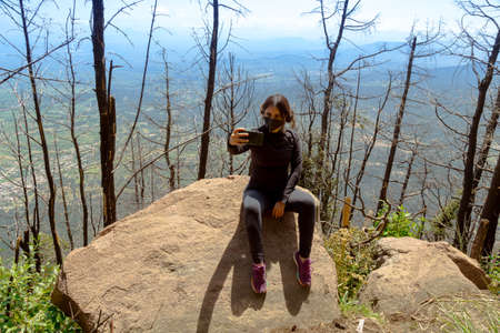 Emotional Woman Vlogging on The Mountain Top.lifestyle women travel and relax concept.