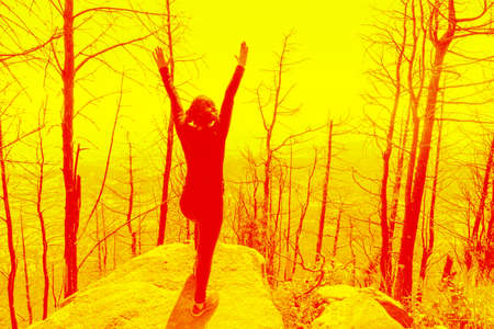 woman stands on a hill. Copy space Standard-Bild