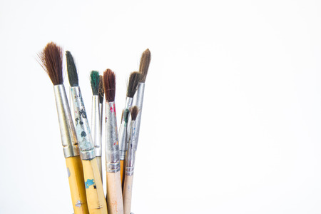 Paint brushes on white background.