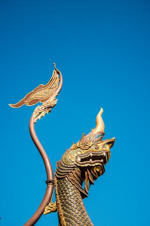 naga china: Wood carved serpent on blue sky background. Stock Photo