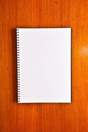 White Blank Notebook on Wood Background photo