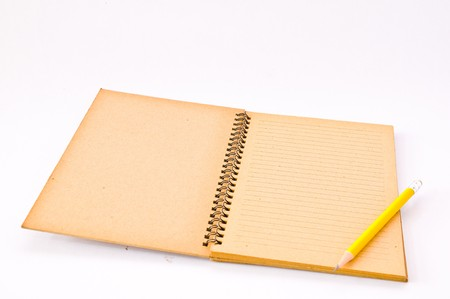 Brown Spiral Notebook with yellow pencil