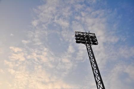 Football Stadium Floodlights with cloud and evening sky photo