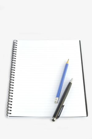 Empty spiral notebook with pencil and pen