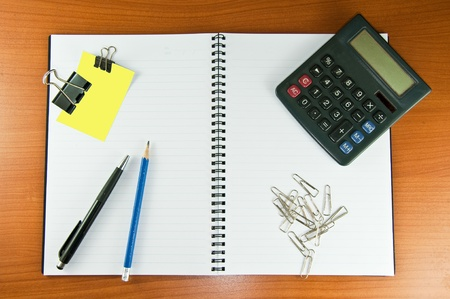 paper clip papernote notebook pen pencil and calculator Stock Photo - 9120406