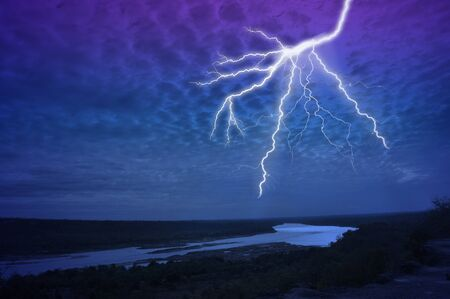 Thunder in the dark night over the river