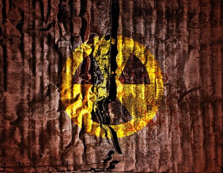 sign of radiation, nuclear warning on grunge metal texture background photo