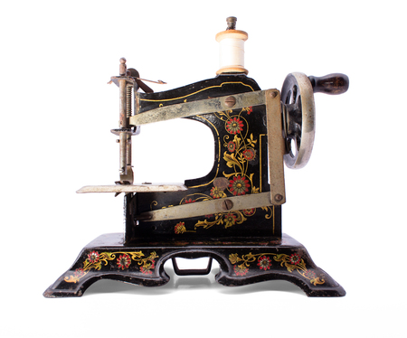 sewing machine: Antique sewing machine on isolated white