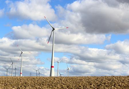 infield: wind-powered turbine electrical generator infield germany Stock Photo
