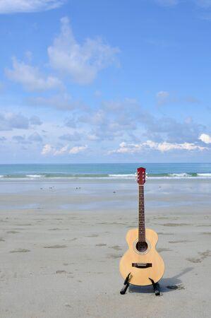 folk music: Guitar on the beach.