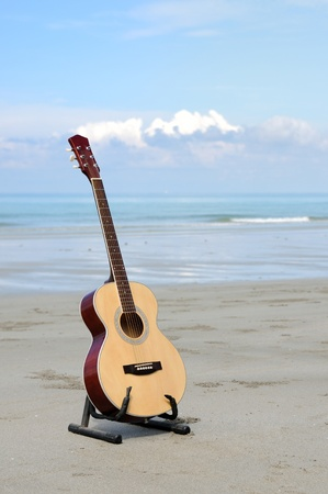 Guitar on the beach. Stock Photo - 9626873