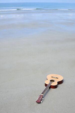 Guitar on the beach. photo
