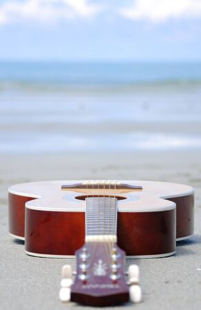 Guitar on the beach. photo