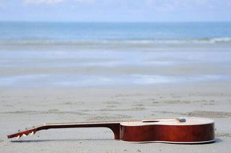 Guitar on the beach. Stock Photo - 9626866