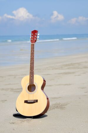 Guitar on the beach. Stock Photo - 9626871