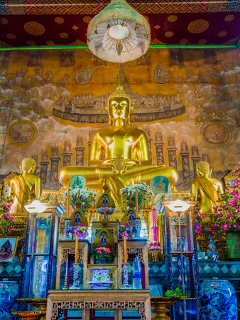 Golden buddha statute and Chief disciple statutes. Editorial