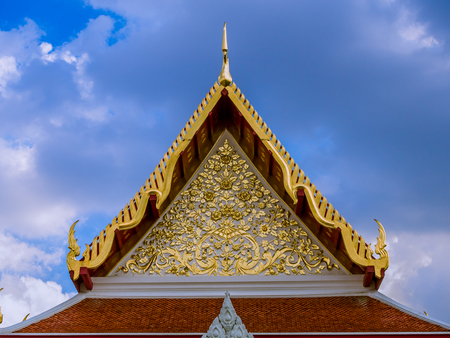 lectern: Golden flowers pattern in tympanum of Thai temple. Stock Photo