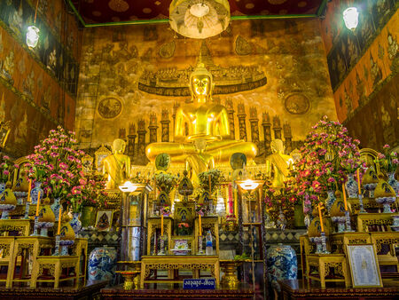 pained: Gold pained Buddha statues in the temple with mural painting. Editorial