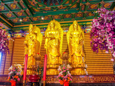 pained: Three standing gold pained Chinese Buddha statues.