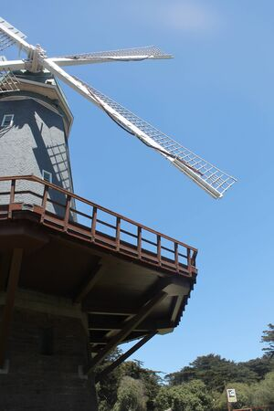 traditional windmill: Traditional windmill with sky and trees in background