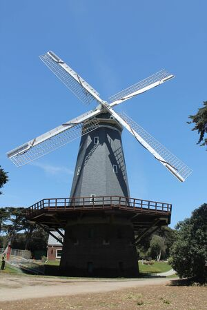 Traditional windmill with trees and bushes around Stok Fotoğraf - 58584263