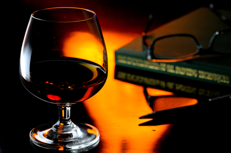 Snifter with brandy on a reflection Stock Photo