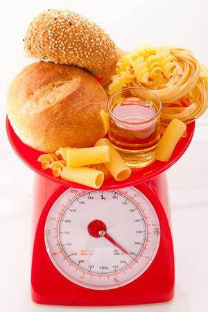 Foods high in carbohydrate on a scales Stock fotó - 85400211