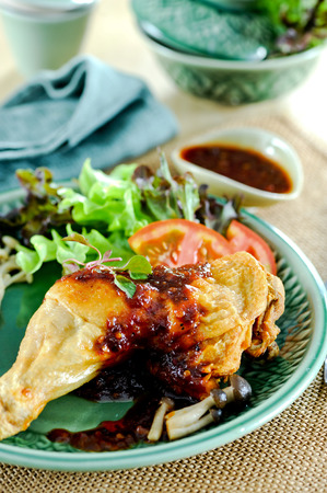 Fried chicken with chili paste,Asian cuisine Stock Photo