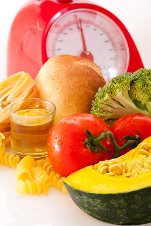 Foods high in carbohydrate on a scales