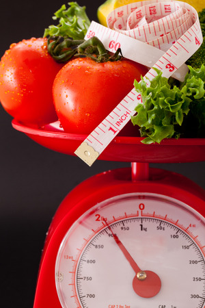 Measuring tape and vegetable on scales
