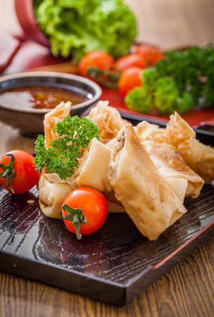 Fried chinese spring rolls with sweet chili sauce. Stock Photo