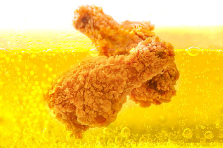 Chicken deep frying in oil