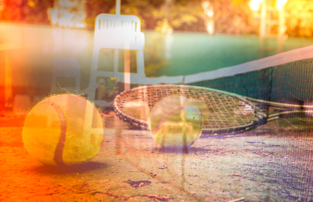 Tennis racket on the Court with the Net in the background Stock Photo