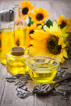 Sunflower oil in bottle glass with seed Stock Photo