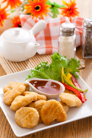 Fried chicken nuggets with ketchup Stock Photo