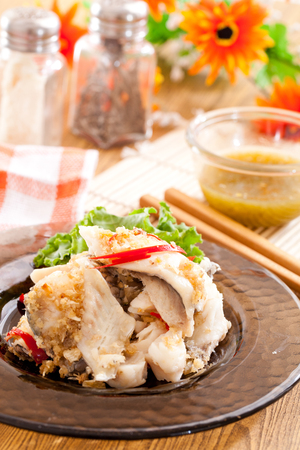 Steamed Fish with fried sliced garlic