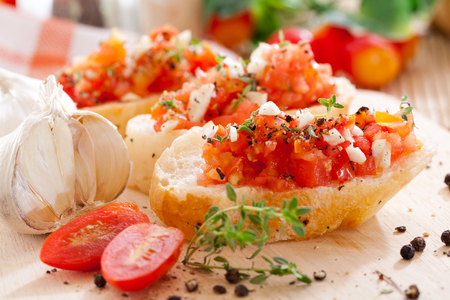 Bruschetta with Tomatoes and Some Ingredients