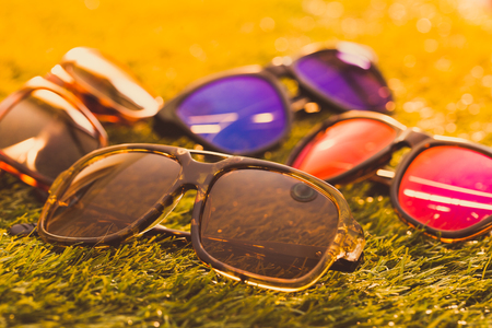 Collection of sunglasses on grass background Stok Fotoğraf