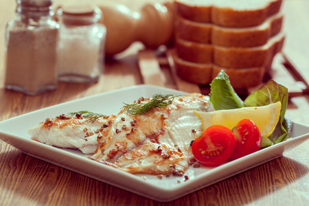 Grilled fish steak with vegetables