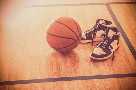 Basketball court with ball and shoes Stock Photo