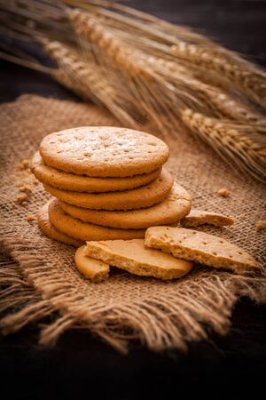 Stack of biscuits with wheat