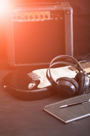 Music notes, Guitar and headphone on stage 스톡 콘텐츠