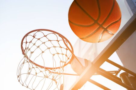 Basketball going through the hoop at out door 스톡 콘텐츠