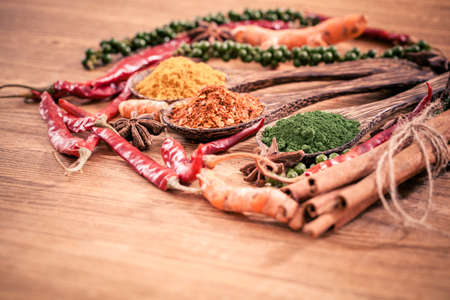 Variety spices in the spoons on wooden background 스톡 콘텐츠