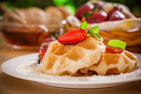 Homemade Belgian Waffles with Strawberries and Syrup