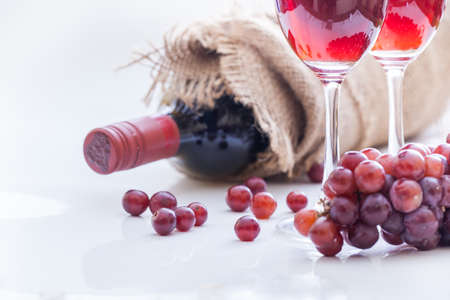 Red wine and grape, white background