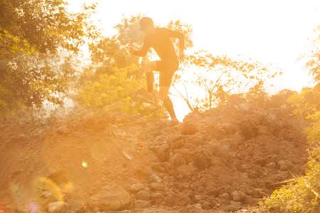 Trail running at the sunset