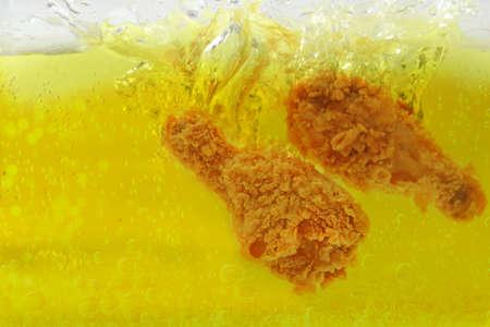 Cooking oil splash  deep  fried chicken Stok Fotoğraf